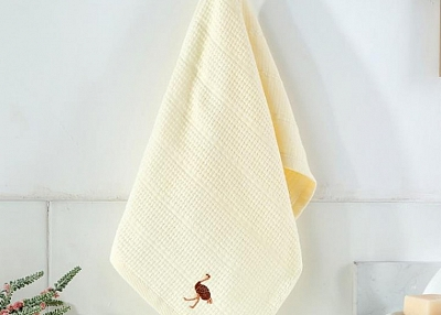 Solid color embroidered face towel
